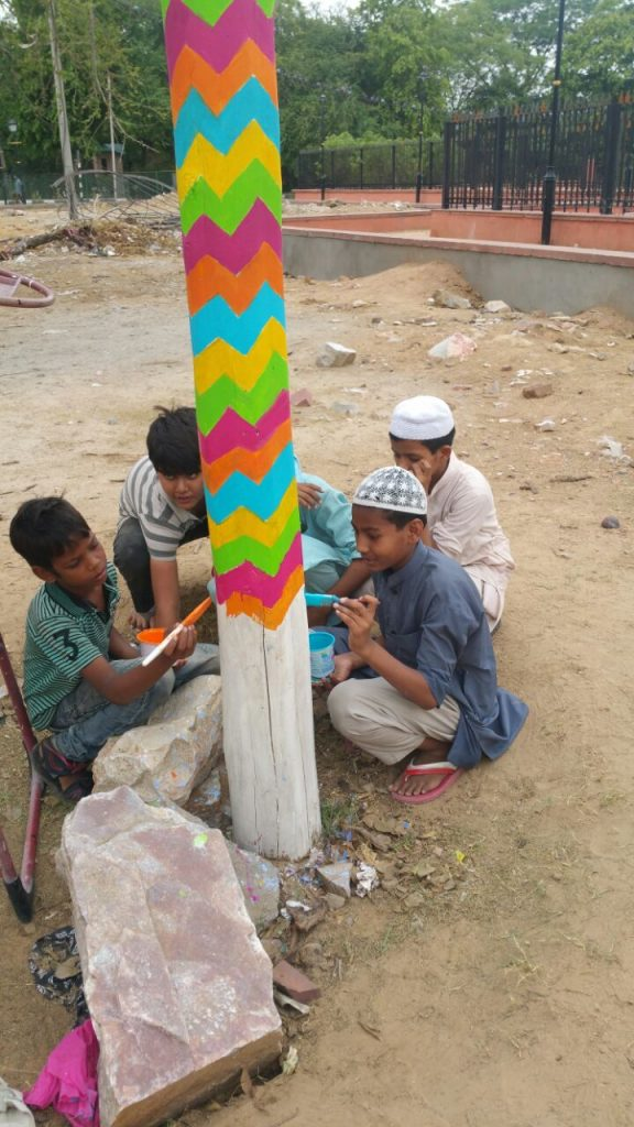Children from the neighbourhood areas also join in the painting process